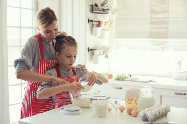 44715959 - mom with her 9 years old daughter are cooking in the kitchen to mothers day, lifestyle photo series in bright home interior